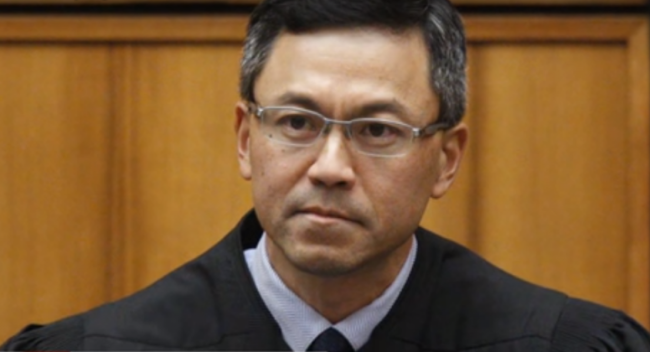 U.S. District Judge Derrick Watson in Honolulu. Photo taken from video.