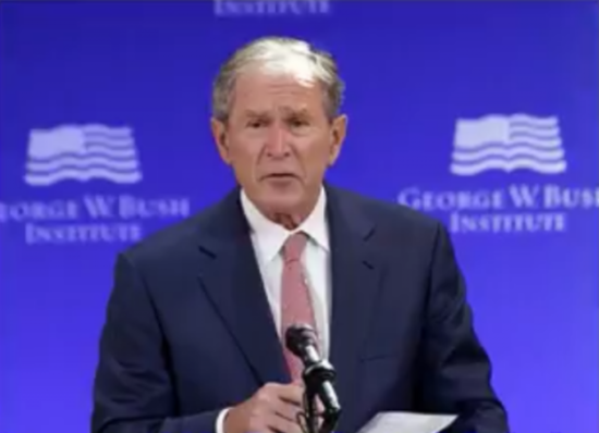 Bush bashes Cheney and Rumsfeld. Photo captured from video.